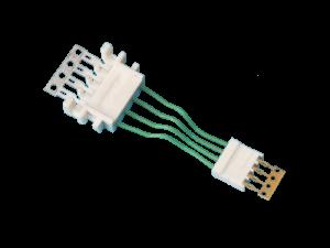 Pièce de connectique avec surmoulage de câble